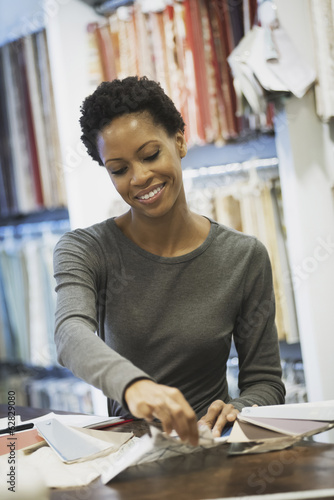 Woman working in design shop
