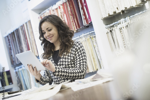 Woman working in design shop with tablet