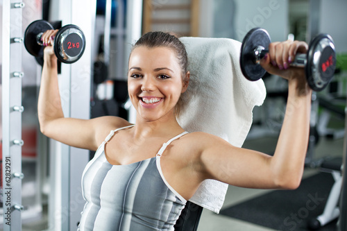 Young woman doing shoulder exercise