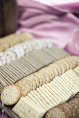 A tray of cheese crackers and biscuits laid out. A choice of shapes and flavours.