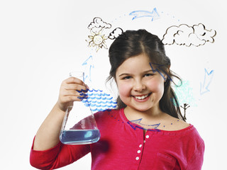 A young girl holding a conical flask of blue liquid in front of an evaporation cycle illustration drawn on a clear surface.