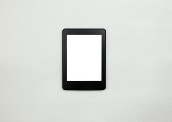 E-book reader or tablet pc on paper background