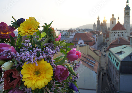 Prague view and beautiful bouquet of flowers