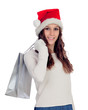 Attractive casual girl with Christmas hat shopping