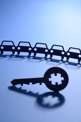 cars in chain with jigsaw key