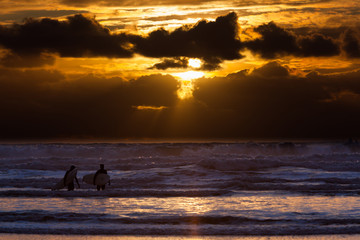 Surfers on Cannon Beach, Oregon, USA