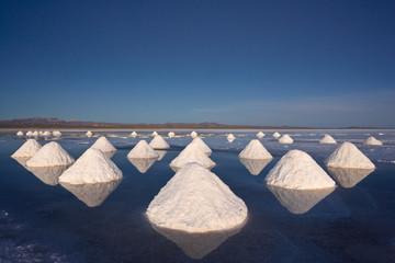 Piles of salt dry in the arid atmosphere of Bolivia's Salar de Uyuni.