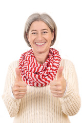 Happy matured woman with thumbs up