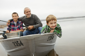A day out at Ashokan lake. A man and two boys fishing from a boat.
