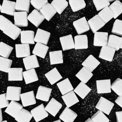 Overhead view of sugar cubes on black backdrop
