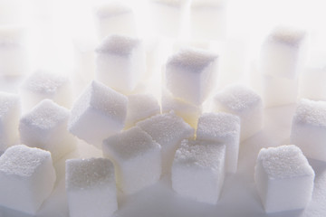 Sugar cubes on white backdrop