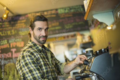 A coffee shop and cafe in High Falls called The Last Bite. A man making coffee.