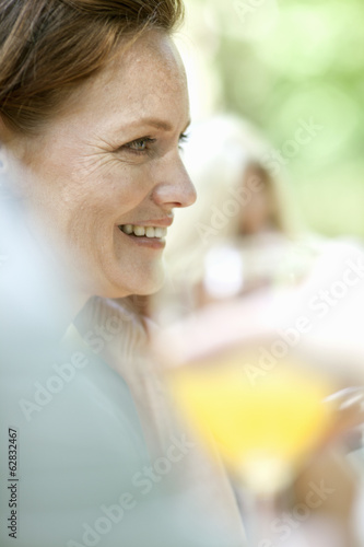 A woman sitting at a table outdoors.