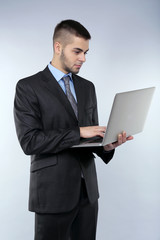 Business man on grey background