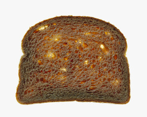 Slice of organic whole wheat bread on a white background