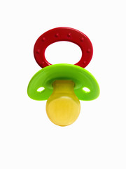 A coloured plastic baby pacifier, dummy or soother.