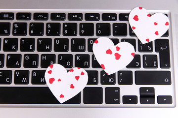 Bright hearts on computer keyboard close up