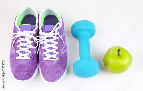 canvas print picture Sneakers and sport equipment. Conceptual photo of fitness