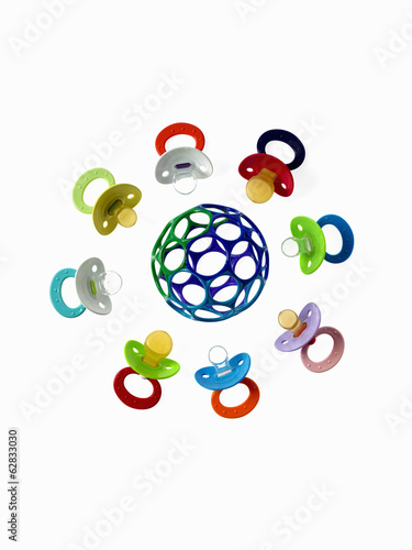 Coloured plastic baby pacifiers, dummies or soothers.