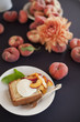 Fresh fruit and flowers. A slice of organic peach cake with a serving of creme fraiche and doughnut peaches.