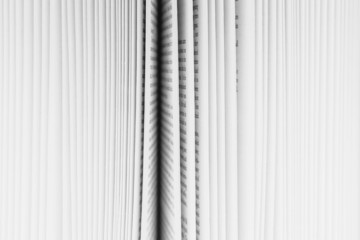 Close up of a book with the pages slightly fanned out, with a black paper edge in the centre.