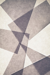 Overlapping pieces of recycled paper