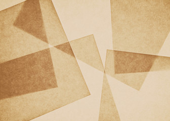 Overlapping pieces of recycled paper.