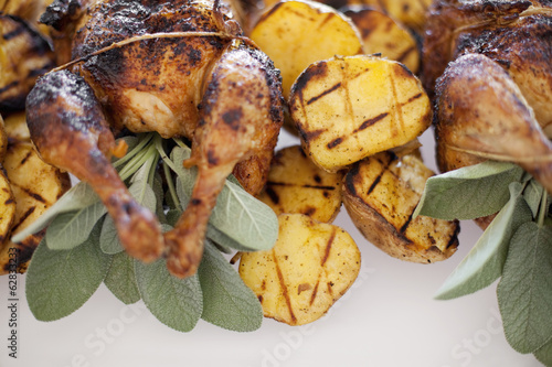 Organic free-range cooked chicken and roasted potatoes on a dish. Food for a party.