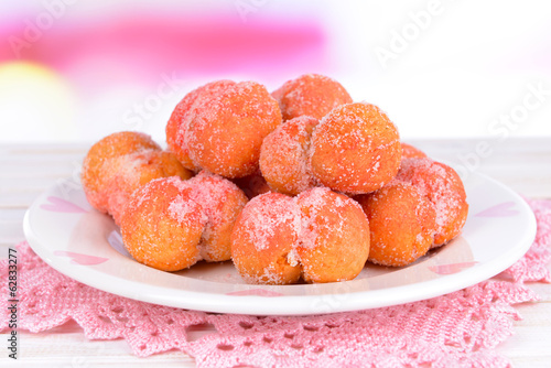 Delicious cookies peaches on table on light background