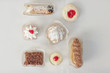 A selection of party desserts, organic food, and dainty cakes and pastries.