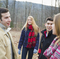 A group of four people outdoors on a winter day.