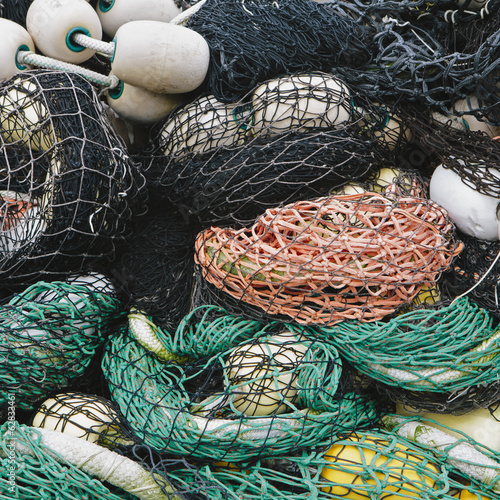 Pile of commercial fishing nets, with white floats, on the quayside at Fisherman's Terminal, Seattle.