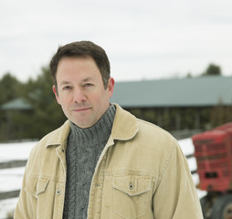 A mature man in a barn coat