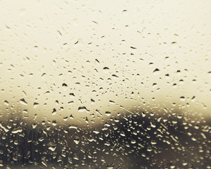 Rain water droplets on a window. View through the window on a rainy day. Seattle