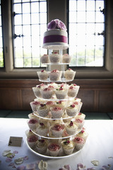 Frosted cupcakes on a seven tier cake stand, a cupcake wedding cake.