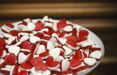 A plate of red and white heart-shaped sweets.