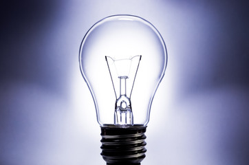 Electric light bulb with light background