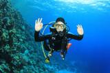 Young woman scuba diving having fun