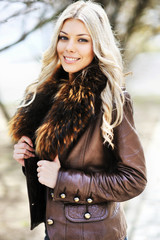 Outdoor portrait of young beautiful stylish woman