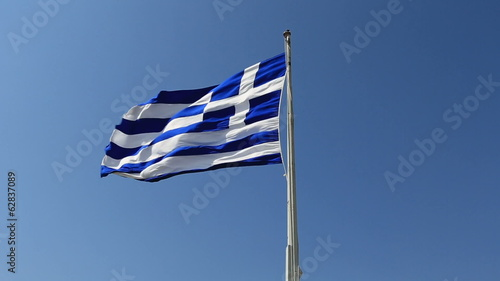 Greek flag waving in the wind and clear blue sky