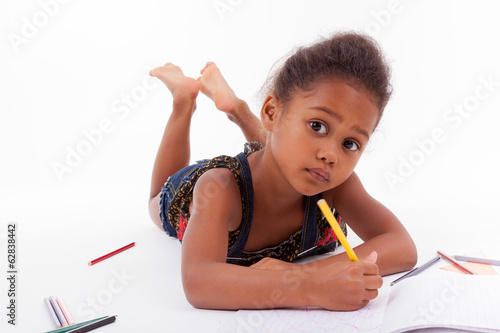 Little African Asian girl  drawing