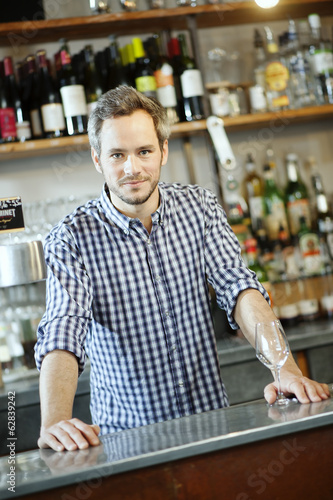 young bartender at his workplace