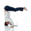 Concept of ??multitasking - businessman doing yoga