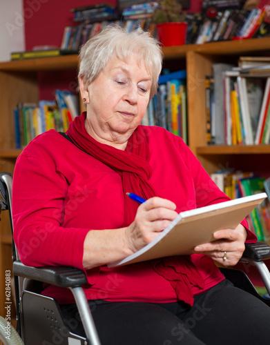 female senior writing a letter