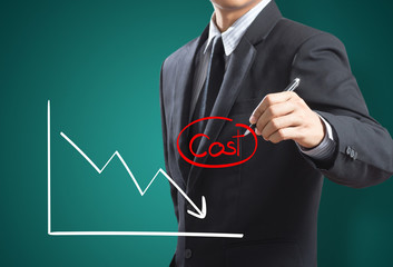 Business man drawing graph of profit compare with cost