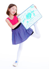 Schoolgirl girl with the tablet shows his drawing.