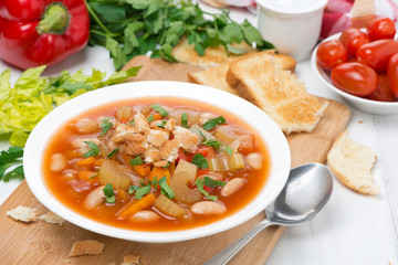 minestrone with vegetables, beans and croutons in a plate