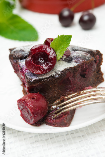 piece of chocolate Clafoutis with cherries and powdered sugar