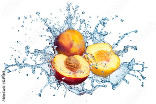 canvas print picture Peach in spray of water.