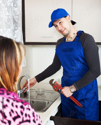 Girl watching as man repairing